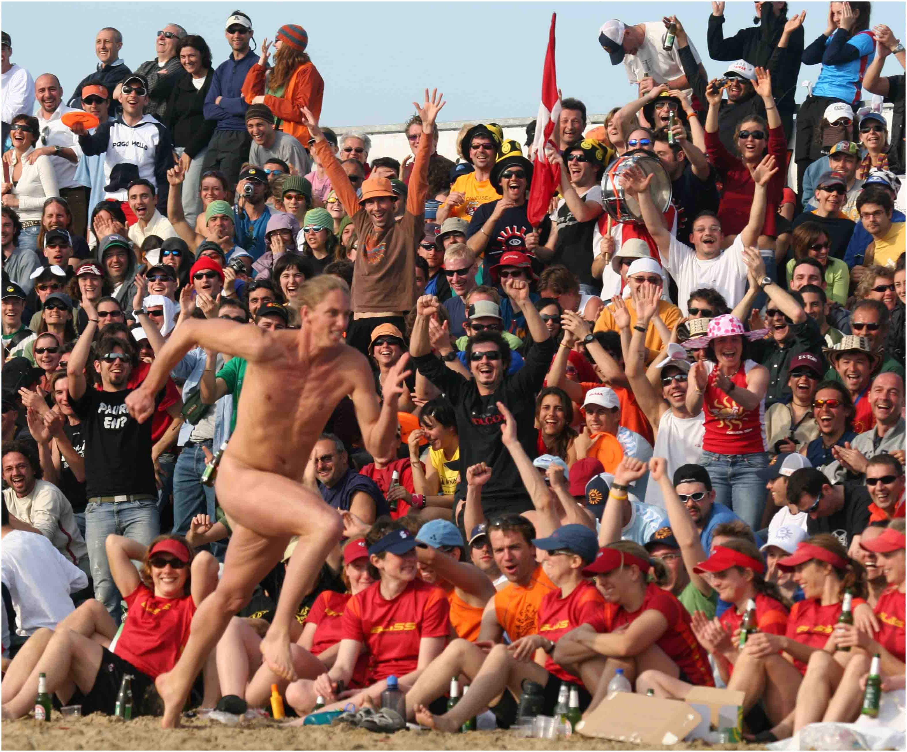 man working beach sand people sun sport crowd summer au nce cheering italy events sports romagna
